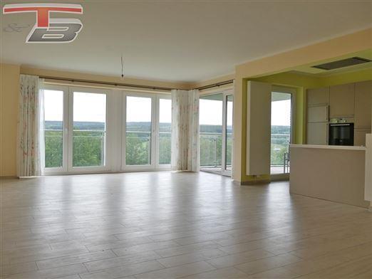 Appartement 2 chambres de 98 m² de standing avec garage et terrasse plein sud offrant vue panoramique imprenable.