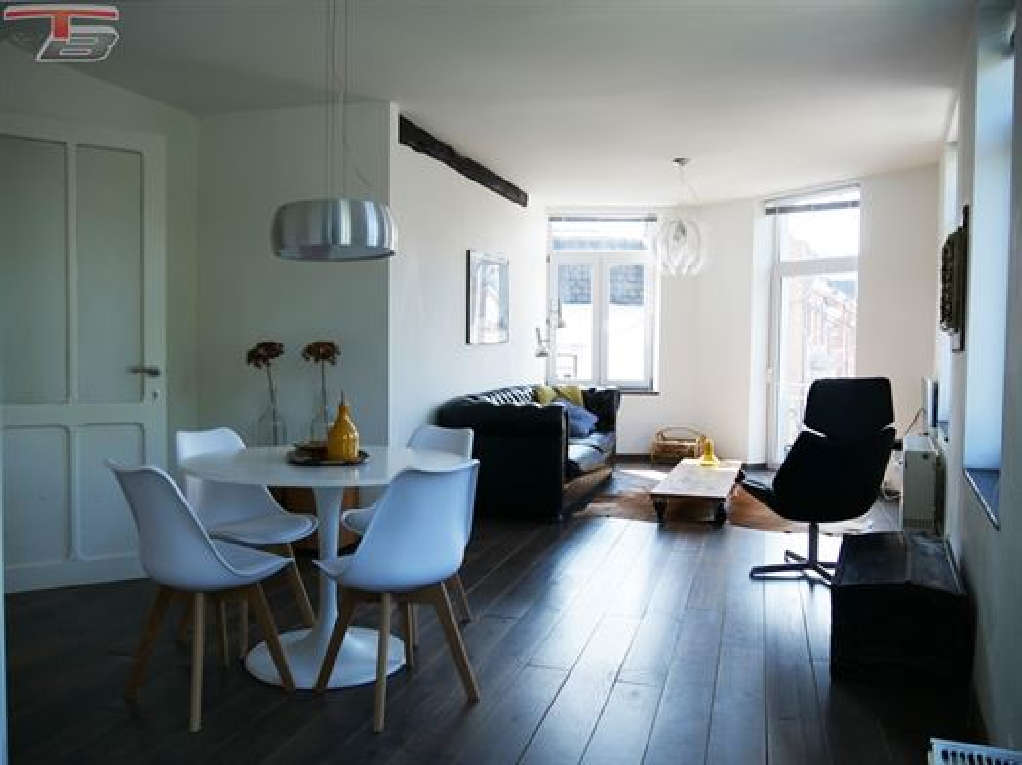 Immeuble de rapport de 371 m² habitables avec garages à proximité immédiate du centre-ville.