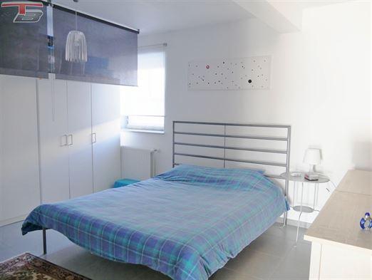 Lumineux appartement 2 chambres de 87m² avec garage, terrasse et jardin privatif exposés sud