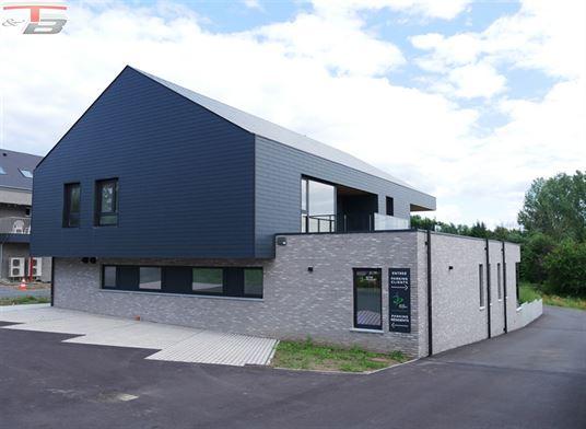 Appartement 2 chambres de 80m² avec terrasse bien exposée et parkings privatifs