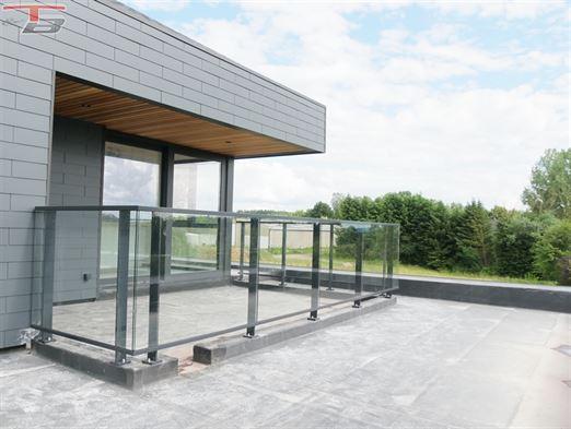 Appartement 2 chambres de 78m² situé en arrière zone avec terrasse de 14,39m² bien exposée et parkings privatifs